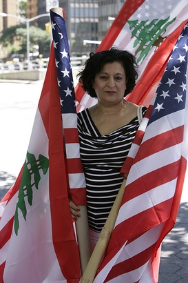A Lebanese-American protester stands outside of the UN  building ...